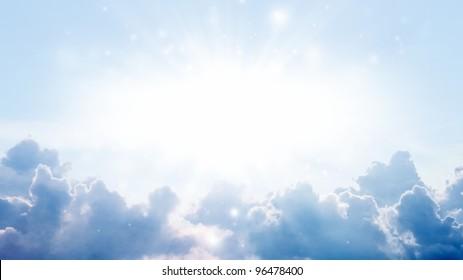 Peaceful background - bright sun, blue sky, white clouds - heaven