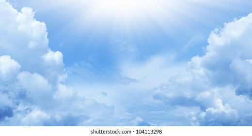 Peaceful background - bright sun shines, blue sky, white clouds - heaven