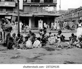At the peak of India's famine in late October 1943 Starving homeless people huddle in a Calcutta street.