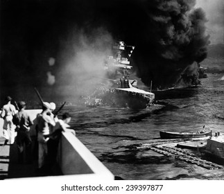 Pearl Harbor: Battered by aerial bombs and torpedoes, the U.S.S. California is evacuated as sailors and soldiers look on, December 7, 1941