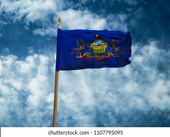 Pennsylvania flag USA flag Silk waving flag made transparent fabric of Pennsylvania US state with wooden flagpole gold spear on background blue sky white smoke clouds real retro photo 3d illustration
