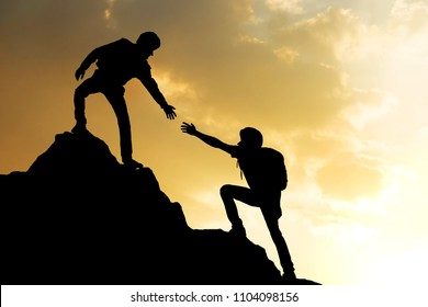 People helping on peak mountain and sunrise background climbing team work success business concept