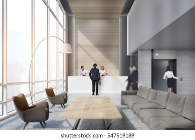 People in the office waiting area with sofas, armchairs, large wooden table and a reception counter. An elevator is seen in the background. 3d rendering. Mock up. Toned image