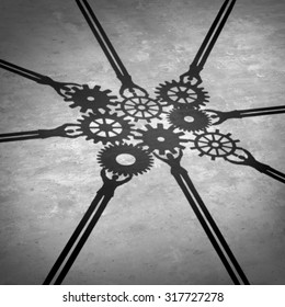 People teamwork holding gears connected together as a social community group symbol or business concept working for a common cause with cast shadows holding a cogwheel network in a team partnership.