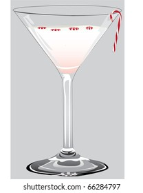 A Peppermint martini complete with a tiny candy cane and mints on top.