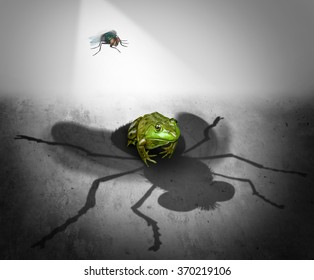 Perception and reality as the giant cast shadow of a small bug falling on a fearful frog as a psychological metaphor for false impression or delusion and misconception symbol.