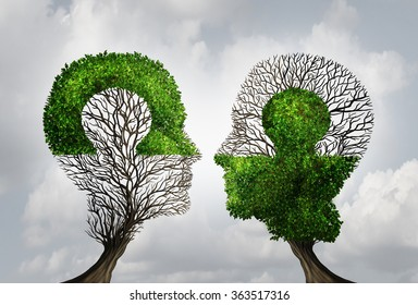 Perfect business partnership as a connecting puzzle shaped as two trees in the form of human heads connecting together as a corporate success metaphor for cooperation and agreement as equal partners.