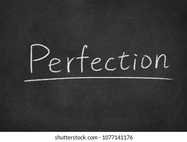 perfection concept word on a blackboard background