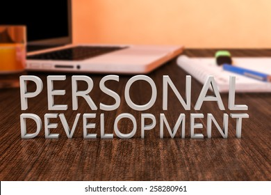 Personal Development - letters on wooden desk with laptop computer and a notebook. 3d render illustration.