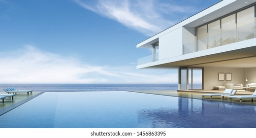 Perspective of modern luxury building with wood terrace and swimming pool on sea view background,Idea of family vacation. 3D rendering.