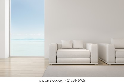 Perspective of modern luxury living room with white sofa on sea view background,Relaxation idea of family vacation, architecture idea of large window system - 3D rendering.