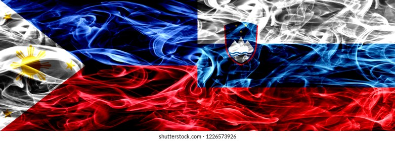 Philippines vs Slovenia, Slovenian smoke flags placed side by side. Thick abstract colored silky smoke flags