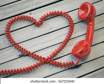 Phone reciever and cord as heart on white wooden background. Love hotline concept. 3d illustration