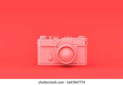 Photo camera, plastic material room accessory in monochrome pink background, 3d rendering, toys and decorative objects