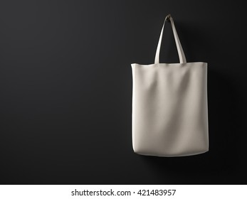 Photo natural color cotton textile material bag hanging right side.Empty concrete painted black wall background.Highly detailed texture, space for your business message.Horizontal mockup. 3D rendering