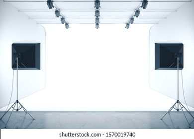 Photo studio with empty white background and professional lighting equipment. Mock up, 3D Rendering