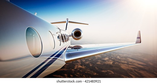 Photo of White Luxury Generic Design Private Jet Flying in Blue Sky at sunset.Uninhabited Desert Mountains Background.Business Travel Picture.Horizontal,Film Effect. 3D rendering