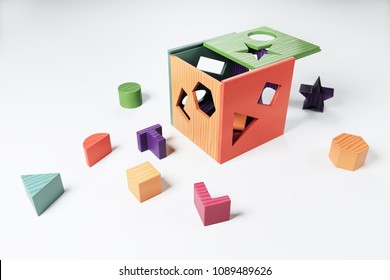 A photo-realistic 3D Rendering of a colorful wooden shape sorting cube baby toy