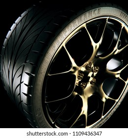 A photo-realistic 3D rendering of a sports car alloy wheel
