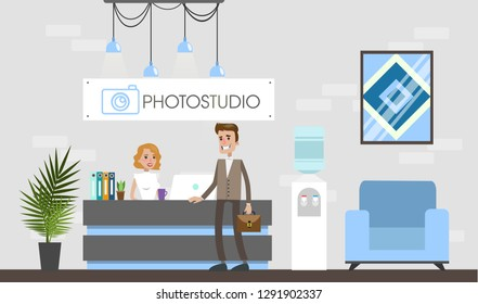 Photostudio interior with people and equipment. Reception