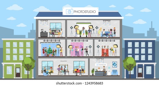 Photostudio interiors city building with people and equipment.