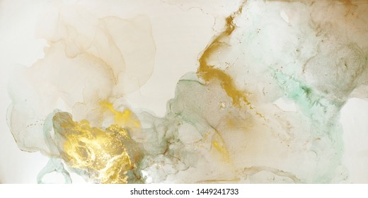 The picture is painted in alcohol ink. Abstraction will perfectly fit into a modern interior. Closeup of the painting. Colorful abstract painting background. Highly-textured paint.