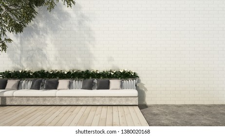 Picture of Patio with long bench sofa on wooden floor deck in brick wall garden - 3D rendering