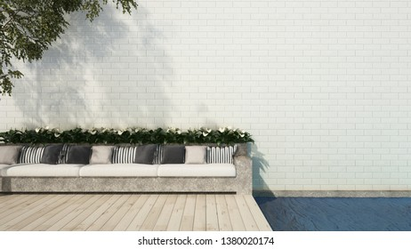 Picture of Patio with long bench sofa on wooden floor swimming pool deck in brick wall garden - 3D rendering