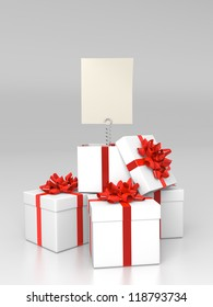 Pile of  gift boxes with blank card
