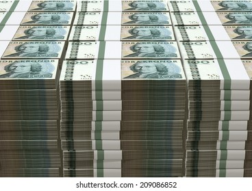 A pile of stacked wads of Swedish Krona banknotes on an isolated background