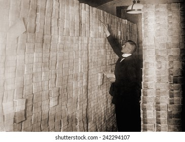 Piles of German money in a Berlin bank during the post-World War I hyper-inflation. In 1923 an American dollar was worth 800 million German marks.