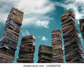Piles of old books on the sky background.