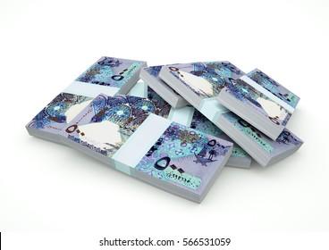 Piles of Qatar Money isolated on white background