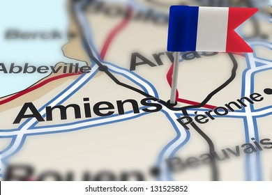 pin with flag of France in Amiens with selective focus