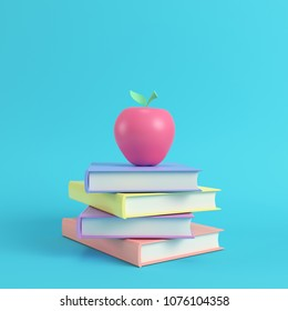Pink apple on a stack of books on bright blue background in pastel colors. Minimalism concept. 3d render