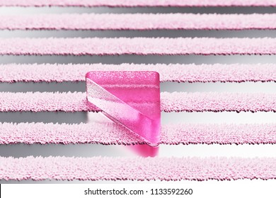Pink Caret Up Glass Icon on Metalllic Striped Background. 3D Illustration of Pink Arrow, Caret, Drop Up, Up, Upload Icon Set With Stripe Metalllic Pattern.