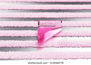 Pink Caret Left Glass Icon on Metalllic Striped Background. 3D Illustration of Pink Arrow, Back, Care, Caret, Left, Previous Icon Set With Stripe Metalllic Pattern.