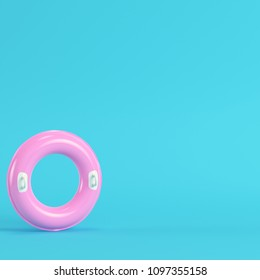 Pink inflatable ring on bright blue background in pastel colors. Minimalism concept. 3d render