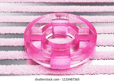 Pink Life Ring Glass Icon on Metalllic Striped Background. 3D Illustration of Pink Floatation Device, Guardar, Life Buoy, Life Ring, Life Save Icon Set With Stripe Metalllic Pattern.