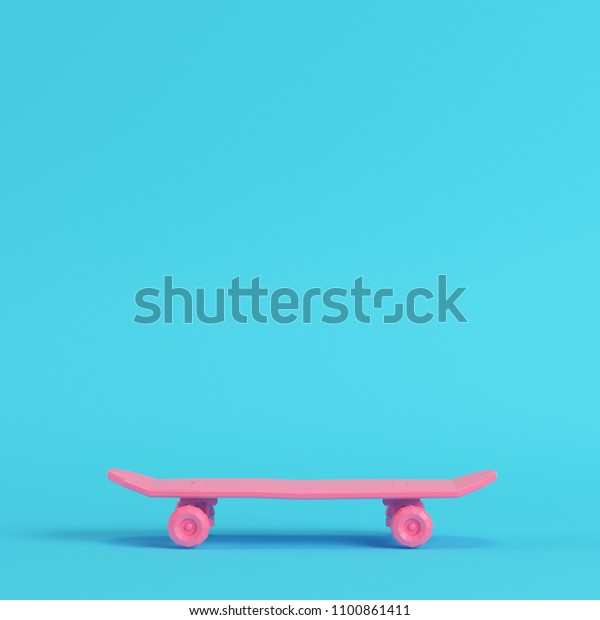 0c17b8f3 Pink low poly skateboard deck on bright blue background in pastel colors.  Minimalism concept.