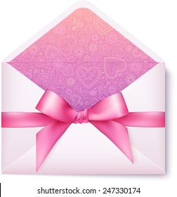 Pink open envelope with pink bow