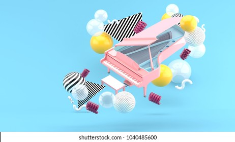 Pink piano among colorful balls on a blue background.-3d render.