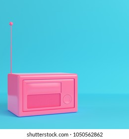 Pink retro styled radio on bright blue background in pastel colors. Minimalism concept. 3d render