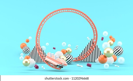 A pink roller coaster among colorful balls on a blue background.-3d rendering.