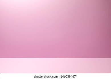 Pink Studio Background for product placement or as a design template with wall angle in a full frame view