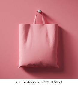 A pink textile shopping bag hangs in the center of the wall. Mock Up. 3d rendering