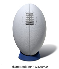 A plain white textured rugby ball with laces on a blue kicking tee on a isolated background