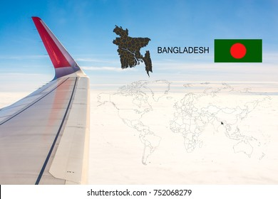 Plan on traveling long distances to Bangladesh.The tail of the plane and Bangladesh map on a world map with flag,On the backdrop is the sky and clouds.