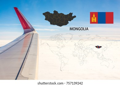 Plan on traveling long distances to Mongolia.The tail of the plane and Mongolia map on a world map with flag,On the backdrop is the sky and clouds.