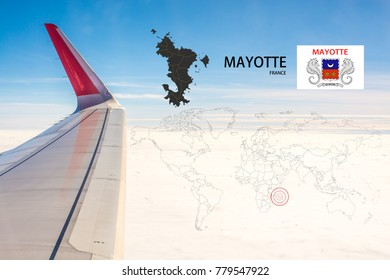 Plan on traveling long distances to Mayotte (France).The tail of the plane and Mayotte (France) map on a world map with flag,On the backdrop is the sky and clouds.